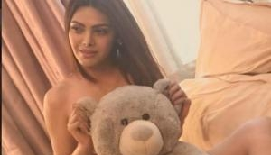 OMG! Sexy diva Sherlyn Chopra goes sans clothes for a steamy hot photoshoot; videos goes viral