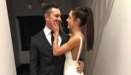Australian fitness trainer Kayla Itsines shared engagement photos with Tobi Pearce on Instagram