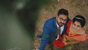 Hilarious! Kerala photographer, Vishnu hung upside down to capture the perfect wedding photograph
