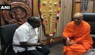 Karnataka poll: JDS' Kumaraswamy meets Nirmalanandanatha Mahaswami