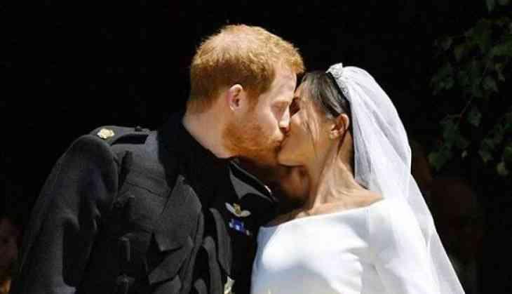 Watch Royal Wedding: Prince Harry and Meghan Markle kiss on St. George's Chapel steps