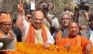 अमित शाह की अगवानी करने पहुंचे BJP सांसद ने एयरपोर्ट पर खड़ा किया हंगामा, ये है वजह