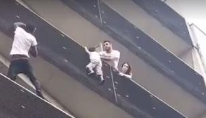 'Real Spiderman' Manlian immigrant scales Paris building to rescue 4-year-old child dangling from balcony
