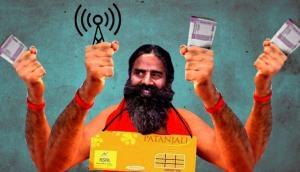 Baba Ramdev enters telecom: Can he master this aasan?
