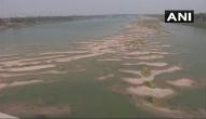 Dry patches of sand appears in stretches of river Ganga