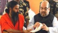 BJP को समर्थन के लिए बाबा रामदेव के पास पहुंचे अमित शाह, योग गुरु ने कह दिया ये..