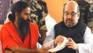 Sampark for Samarthan: Amit Shah seeks support from Ramdev