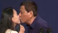 राष्ट्रपति ने महिला को मंच पर बुलाकर किया KISS, मच गया बवाल