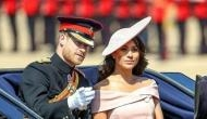 Meghan Markle wore bare-shouldered Carolina Herrera dress and her first bouncy blowout at Trooping the Colour parade