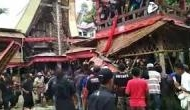 Watch Video: Mother's coffin falls on son in Indonesia funeral