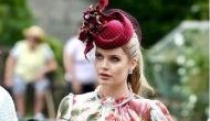 Lady Kitty Spencer wore an elegant floral dress to the wedding of Prince Harry's cousin