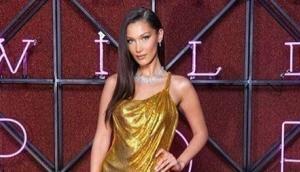Bella Hadid stuns in a sexy gold Versace dress at Bulgari dinner in Rome