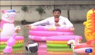 This Pakistani reporter goes overboard to cover monsoon floods