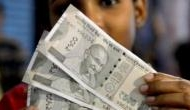 Rupee rises 14 paise to 70.90 against USD in early trade