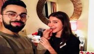 Virat Kohli shared a kissing picture with Anushka Sharma; fans trolled him for hairstyle and said 'bal ud gaye bhai k?'