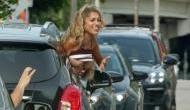 Woman flashes her breast at David Beckham out of her car window in Miami