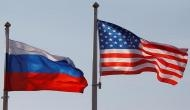 Russian woman arrested, accused of acting as agent in US
