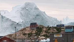 Watch Video: Massive melting iceberg threatens Greenland village