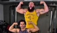 Bollywood actor Varun Dhawan flex muscle with WWE superstar Braun Strowman
