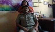 दिल्ली पुुलिस के SHO का साध्वी से मालिश करवाने की फोटो वायरल होने के बाद हुआ ट्रांसफर