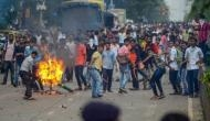 Assam bandh: Protestors squat on tracks, burn tyres