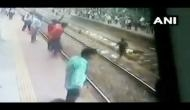Maharashtra: Man lies on railway track in suicide attempt; see video