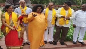 Andhra Pradesh Special status: TDP MP dons Sathya Sai avatar