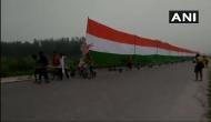 Uttar Pradesh: 35 Kanwar pilgrims carry 361-feet long tricolour