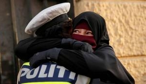Viral Photo: Amidst Denmark's face veil ban, see cop embracing woman in burka