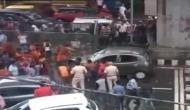 Video: Anguished Kanwar pilgrims vandalises, topples woman's car after being brushed in Delhi