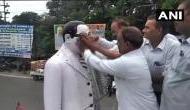 RSS के राकेश सिन्हा ने अंबेडकर की मूर्ति को पहनाई माला तो दलितों ने गंगाजल से किया शुद्धिकरण