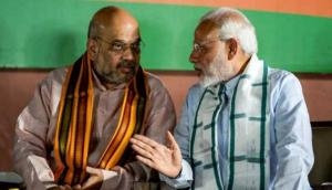 गुजरात : उत्तर भारतीयों पर हमलों को लेकर PM मोदी और शाह ने लगाई CM रूपाणी को फटकार