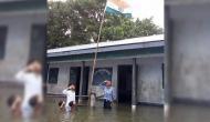 बाढ़ के पानी में डूबकर तिरंगे को सलाम ठोकते इस बच्चे को NRC ने किया बाहर