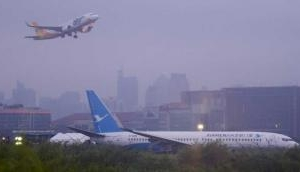 Plane from China skids off Manila runway amid downpour