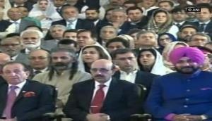 Navjot Singh Sidhu hugs Pakistan Army chief, sits next to PoK head at Imran's swearing in