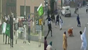Video: कश्मीर के अनंतनाग में बकरीद पर पुलिस की गाड़ी पर लोगों ने बरसाए पत्थर और लाठियां