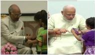 Raksha Bandhan: Children tie Rakhi to PM Modi, President Ram Nath Kovind