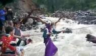 Uttarakhand: Sans bridge, villagers use rope to cross river