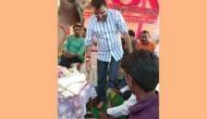 Video: BJP सांसद ने कार्यकर्ता से पहले धुलवाए पैर और फिर फेसबुक पर शेयर किया वीडियो
