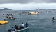 Air Niugini plane overshoots runway and crashes into the Pacific Ocean in Micronesia; passengers swim for their lives