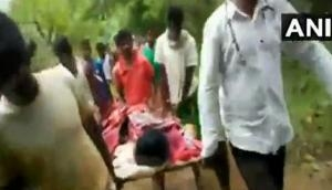 Odisha: Shocking! Ailing local carried on cot to hospital due to inadequate infrastructure