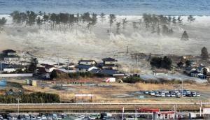 Tsunami and earthquake in Indonesia kill over 400