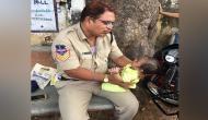Telangana: Cop babysits child while mother writes exam