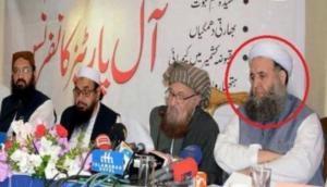 पाकिस्तान: इमरान खान की फिर खुली पोल, आतंकी हाफिज सईद के साथ मंच साझा करते दिखे उनके मंत्री
