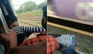 ट्रेन के दरवाजे पर लटककर सफर कर रही थी ये लड़की, हाथ फिसला और...