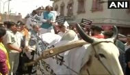 Delhi: Vijay Goel rides a bullock cart in Chandni Chowk to protest against fuel prices hike; confronts Kejriwal
