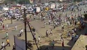 Gujarat: UP, MP and Bihar people thrashed out of the houses in the middle of the night; share horrifying ordeal