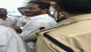 YSR Congress chief Jagan Mohan Reddy stabbed on his arm at Vizag airport by unidentified man