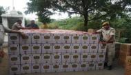 बिस्किट के डिब्बों के नीचे छिपा कर ले जा रहे थे 1 करोड़ की शराब, पुलिस ने दबोचा