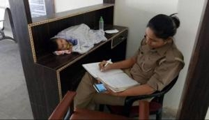 Uttar Pradesh: Salute! Mother cop in Jhansi brings her 6-month-old baby at work; win hearts after picture goes viral